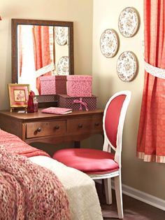 Sitting Pretty - To get all the amenities you want in a small room, use multifunctional furniture pieces. Here, a small desk outfitted with a large mirror serves as both a makeup station and a space for catching up on correspondence. Fabric-covered boxes house cosmetics and writing materials. By blending a primitive country table with a traditional mirror and a painted French-style chair covered in red silk, the mix-and-match design of the room is unmistakable.