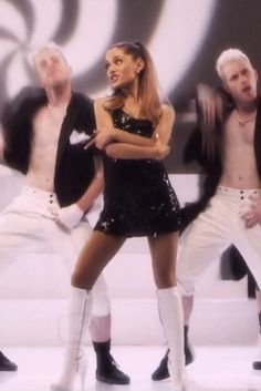 Ariana Grande wearing  Pleaser USA Delight 2000 Boot, Asos Faux Pearl Cone Stud Earrings, Steffen Schraut Sequined Madrid Mini-Dress