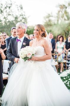 Feast your eyes upon a sunset wedding filled with the colors of the desert and a signature lavender hue that paid homage to the Groom's mother in such a sweet way. Designed by Some Like It Classic, with florals by The Flower Studio and