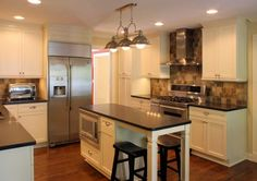Platinum Kitchens: Kitchens.  Island with seating in narrow kitchen.