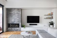 33 Stunning Modern Fireplace Design Ideas With TV Above - Modern fireplaces not just about heating the house, they are also about interior design. They are still functional and economical, but their aesthetic. Fireplace Tv Wall, Fireplace Surrounds, Fireplace Design, Fireplace Stone, Living Room Tv, Living Room With Fireplace, Home And Living, Family Room Design, Home Deco