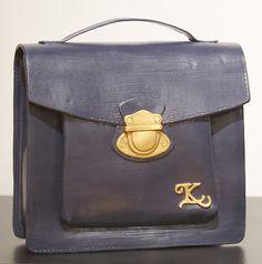 Dark blue clay purse.