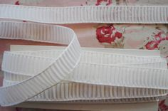 Antique Vintage French Plisse Ruched Millinery Ribbon Trim Pretty Pleated Ribbon Crispy White Made of Rayonne ~ Soft and Pliable Unused old store stock ~ Made in France, c1930s Excellent Condition 1 yard listing ~ approx. 5/8 wide Wonderful to use with millinery projects, ribbonart, wedding, and other crafting projects. Thanks for stopping by! I love to combine shipping