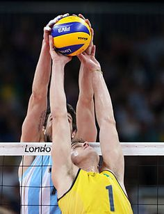 Bruno Rezende #1 of Brazil & Facundo Conte #7 of Argentina fight for the ball in Men's volleyball