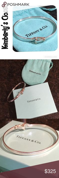 """✨TIFFANY & Co Hook & Eye Bangle Bracelet % AUTHENTIC TIFFANY & Co Hook and Eye bangle bracelet.  Sterling silver with 18k gold accent.  Comes with original box with item ID label and jewelry pouch (see photo).  Measures 2.5"""" across from side to side.  Opens for easy on off (see photo).  Bracelet was not worn often.  Small scratch marks in silver (mostly on back side - see photo) just from the general way silver wears.  Matching ring also listed in my closet - bundle and save! Tiffany & Co…"""