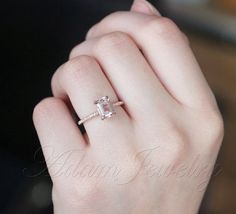 Pink emerald cut engagement ring from AdamJewelry on Etsy for only $385. So delicate and understated!