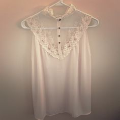 Beautiful flowy lace top Around the neck. Buttons come undone. Never worn. Large fits like small/medium Love 21 Tops Blouses