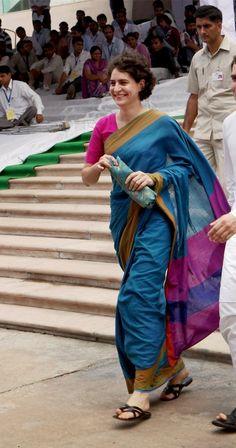 priyanka gandhi strides in vibrantly colored handloom sari