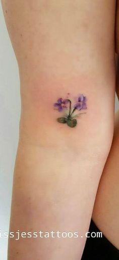 Tiny violets by Jess Hannigan Violet Flower Tattoos, Violet Tattoo, Small Flower Tattoos, Flower Tattoo Designs, Tattoo Designs For Women, Small Tattoos, Tattoos For Women, Time Tattoos, Body Art Tattoos