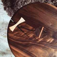 Salvage walnut offcut stool with maple butterfly and wedged round through tenon joinery $400