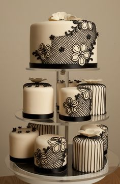 Small black and cream lace cake with mini cakes