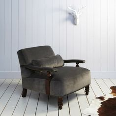 In voluminous velvet with stud detailing and turned wood legs and arm supports, this generously proportioned armchair comes complete with a feather filled lumbar cushion