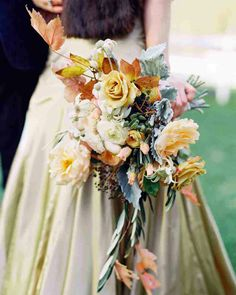 Fall/Autumn Wedding Bouquet: Champagne Roses, White Ranunculus, Deep Blue Privet Berries, Succulents, Peach Spray Roses, Dusty Miller, Autumn Foliage
