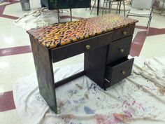 An old desk repainted with a wild spirit.