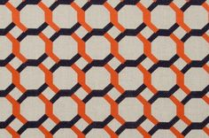 A multipurpose upholstery and drapery fabric in a geometric design of embroidered navy blue and orange on a natural linen background. Each