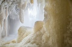 Ice Cave - Single silhouette of a person from icy cave in sunny and frosty January afternoon on Jagala waterfall, Estonia. Photography by  Aleksei Velizhanin