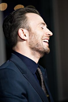 Who says black suits are only for funerals or tuxedos? :Chris Evans