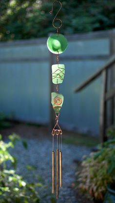 A beautiful glass and copper sun catcher wind chime- inspired by nature. The 3 nice glass pieces are artist-made beach glass, smooth with a mat finish. This chime measures 26 inches long from the top