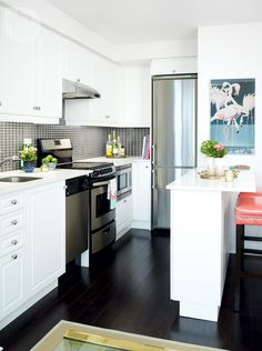 Stylish kitchen—The kitchen is compact but features all the essentials, including a microwave tucked under the counter, a slender fridge and a peninsula offering enough seating to eliminate the need for a formal dining area.