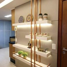 Make your apartment appear Luxurious with minute details. White floating shelves with glissy gold paint bars adds to the richness of room. Living Room Partition, Room Partition Designs, Shelf Design, Design Case, Home Decor Furniture, Furniture Design, Metal Furniture, Living Room Designs, Living Room Decor