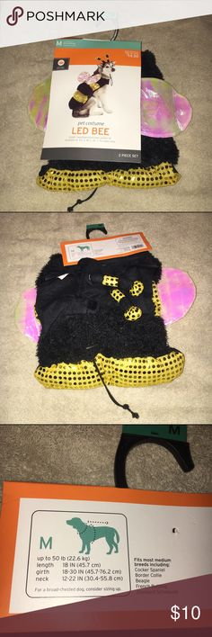 Halloween Bumble Bee Pet Costume Halloween Bumble Bee Pet Costume. Size medium. Brand new and in original packaging. Lighted wings do not appear to work and so the item has been discounted. Other