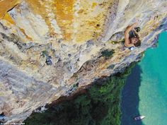 Climber Tom Socias scales the third pitch of Lord of the Thais in Thailand, with crystal clear waters seen below(the above image is included in the new book)