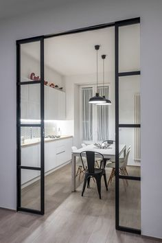 View the full picture gallery of Appartamento MB Modern Kitchen Design, Interior Design Kitchen, Interior Decorating, Kitchen Decor, Küchen Design, House Design, Kitchen Sliding Doors, Home Living, Minimalist Home