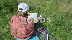 Video footage. Pond5.com. The girl draws a mountain landscape from life.    #hour #tree #plaid #talent #green #view #yellow #grass #pastel #paint #sun #countryside #portrait #creative #palette #therapy #brush #girl #young #frame #workshop #woman #beauty #sketch #mountain #rural #school #outdoors #picture #rug #art #draw #hobby #golden #artistic #painter #beautiful #inspiration #board #nature #draft #artist #landscape #gym shoes #female #child #color #sunset #summer #autumn  #Video #footage…