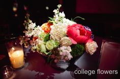 Centerpiece for guest seated tables. A great low style arrangement option. Floral: College Flowers, Lubbock, TX Photography: Lauren Clark Photography