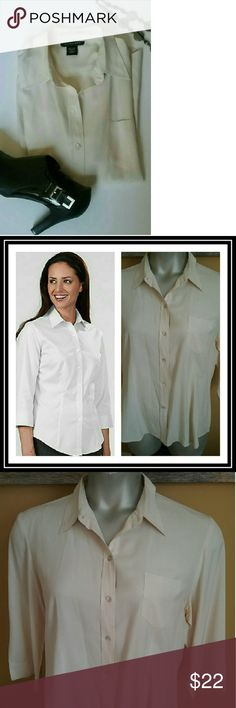"""3/4 length off white dress shirt Beautiful 100% silk off white 3/4 length sleeve blouse. One breast pocket on the  left front. Very well tailored. Length 27"""" in front,  28"""" in back. Sleeves are 19"""" silkland  Tops Button Down Shirts"""