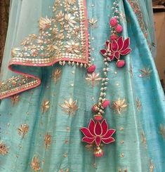The ultimate list of gorgeous Lehenga and Blouse Latkan designs that are ruling the internet. From tassels to pom-pom designs, choose not just one but more. Red Lehenga, Bridal Lehenga, Gota Patti Lehenga, Lehenga Kurta, Lehenga Style, Sharara, Sabyasachi, Indian Dresses, Indian Outfits
