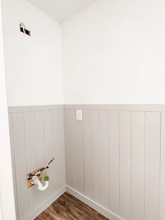 Easy DIY Vertical Shiplap Wainscoting - Bless'er House The perfect beginner DIY project for how to install vertical wood planked walls and add character in any space on a small budget.