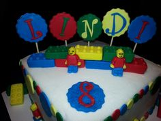 Lego cake - Buttercream frosted, fondant décor.  The Legos & Lego people are made with silicon ice trays.