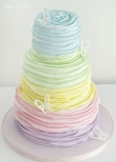 Tiers of ruffled pastel perfection are the stuff wedding cake dreams are made of. #springweddingcakes