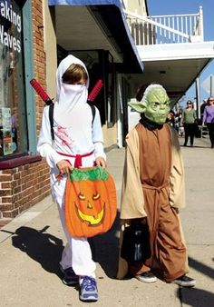 Jen Marra / Costumed children make their way up and down Asbury Avenue in Ocean City visiting the businesses for candy.