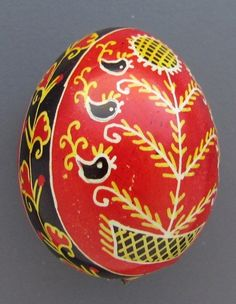 This traditional Quail Pysanka has a colorful design. It was made with the traditional Ukrainian wax and dye technique. This Easter egg was made by real masters of this craft.
