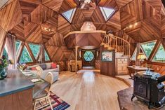 """This one-of-a-kind """"Dome Home"""" features impressive woodwork and a groovy, geodesic design. Geodesic Dome Homes, Light Hardwood Floors, Dome House, Earthship, Round House, Tiny Living, Living Room, House Floor Plans, Cabana"""
