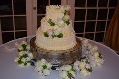 Blush and white roses with green berries girls bouquets have Cotten