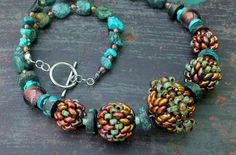 This chunky necklace by NelaKábelová is a great way to show off a collection of Matubo 7/0seed beads and SuperDuos. It's really more of a recipe than a pattern. There are three tutorials for the ...