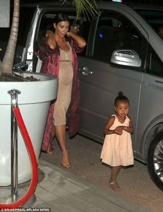She's in charge!Little North was spotted getting out of a hired car with her famous mom before taking charge of the situation - showing she takes after her father Kanye West in having an independent spirit