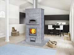Juuka, Finland (PRWEB) November 2014 -- Tulikivi, the world's largest manufacturer of heat-retaining fireplaces made of soapstone, continues to emphasize Stone Fireplace Designs, Modern Fireplace, Built In Ovens, Kitchen Upgrades, Construction, Home Chef, Patio, Smart Home, Kitchen Design