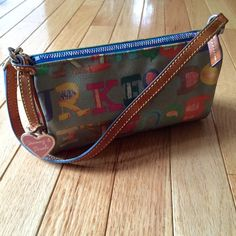 Dooney & Bourke authentic doodle bag Adorable doodle design with rainbow zipper, leather trim, blue cotton interior with key chain clip and zippered pocket and hanging heart medallion. Inside and medallion show some wear - check photos. Smoke free. Dooney & Bourke Bags