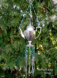 vintage silver teapot and vintage hand stamped silverware wind chime with blue beaded necklace / thriftyrebelvintage.com