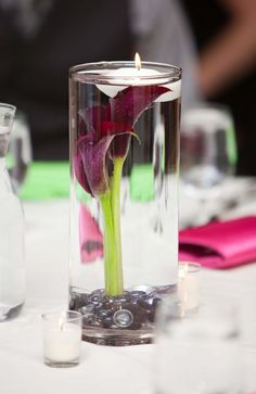 DIY Submerged Calla lily Centerpiece with floating candle. : they have coral calla lilies. Calla Lily Centerpieces, Diy Centerpieces, Purple Centerpiece, Inexpensive Centerpieces, Purple Calla Lilies, Blue Orchids, White Lilies, Purple And Green Wedding, Floating Candles Wedding