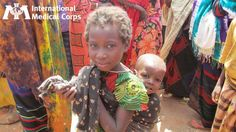 July 12: Two children attend an International Medical Corps-sponsored event to raise awareness about women's rights and gender-based violence in Ethiopia's Dolo Ado refugee camps.     Photo: Annerie Jansen Van Rensburg/International Medical Corps, 2011