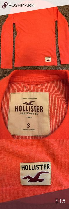 Hollister long sleeve shirt. This is an all but new Hollister long sleeve shirt. It is light weight and vibrant orange shirt. It looks great when on. Hollister Shirts Tees - Long Sleeve
