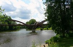 The Midland Tridge is a unique three-legged bridge that crosses the confluence of the Tittabawassee and Chippewa Rivers in downtown Midland, Michigan. It is the starting point of the Pere Marquette Rail Trail, a popular skating and bicycling trail, and crosses over to Midland's Chippewassee Park, the location of many festivals and activities throughout the year.  ~Photograph by Trina Prenzi