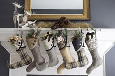 Great idea! Instead of trying match all the stocking holders for the mantle at Christmas, use two stocking holders to hold a curtain rod and hang the stockings from the curtain rod!