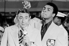 Muhammad Ali checks on Howard Cossell's hair while covering the 1972 US Olympic Boxing Trials for ABC Sports.