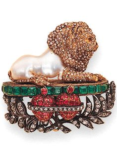 AN ANTIQUE PEARL, DIAMOND, RUBY AND EMERALD LION BROOCH With a baroque pearl body and rose-cut diamond head, mane, paws and tail, the lion lies on an engraved pedestal with square-cut emerald trim and diamond-set leaves to the central ruby-set twin pomegranates (thirteen small diamonds deficient, with concealed pendent hoop), late 19th century